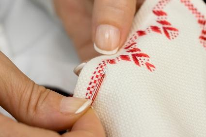 Fabric designing by hand embroidery