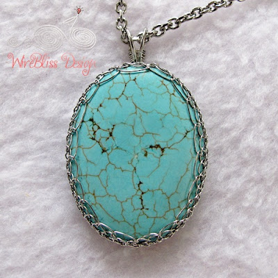 a large netted turquoise pendant by WireBliss