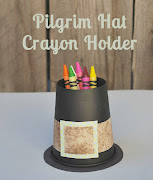 Paper placemats & this pilgrim hat filled with crayons .