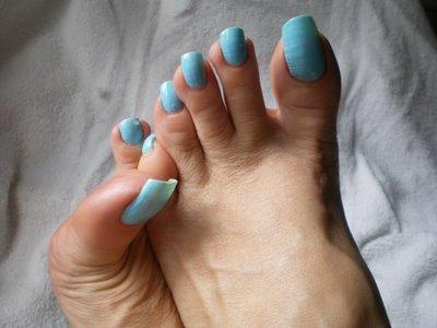 image Orange toenails footjob 2