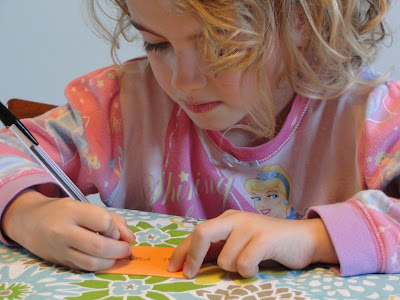 child writing cards
