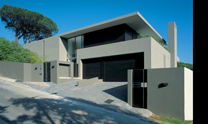 Casas minimalistas y modernas frentes y fachadas minimalistas for Fachadas con terrazas minimalistas