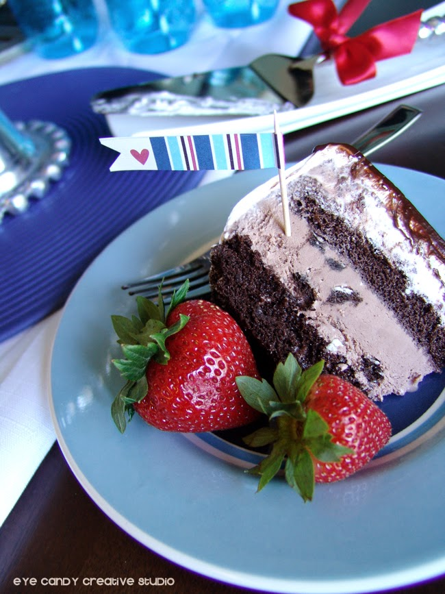 slice of ice cream cake on plate, free flag in cake, strawberries