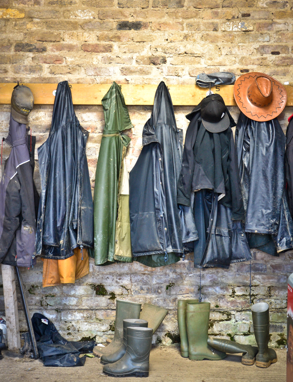 Farmers overalls, coats and boots hung up for the day