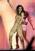 Cheryl Cole in a gold outfit on stage