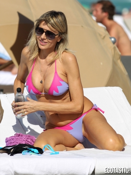 Rita Rusic Sunbathes in a barely-there pink and blue bikini in South ...