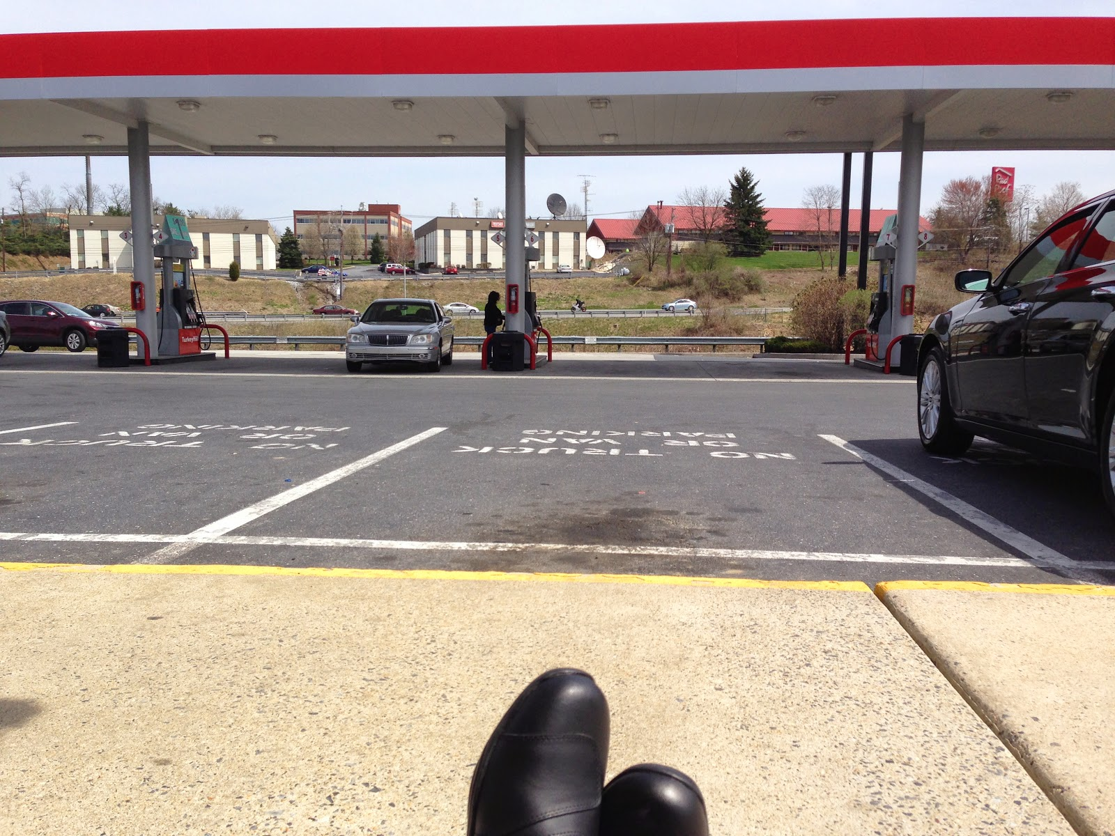 Tigho waiting at a gas station outside of Harrisburg Pa for the boys from 899adventures.com | NYDucati