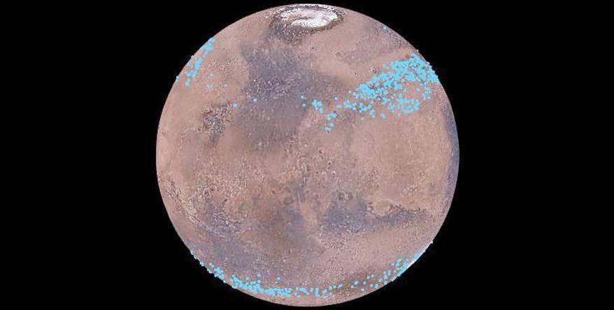 Mars distinct polar ice caps, but Mars also has belts of glaciers at its central latitudes – between the blue lines, in both the southern and northern hemispheres. A thick layer of dust covers the glaciers, so they appear as the surface of the ground, but radar measurements show that there are glaciers composed of frozen water underneath the dust. (Credit: Mars Digital Image Model, NASA/Nanna Karlsson)