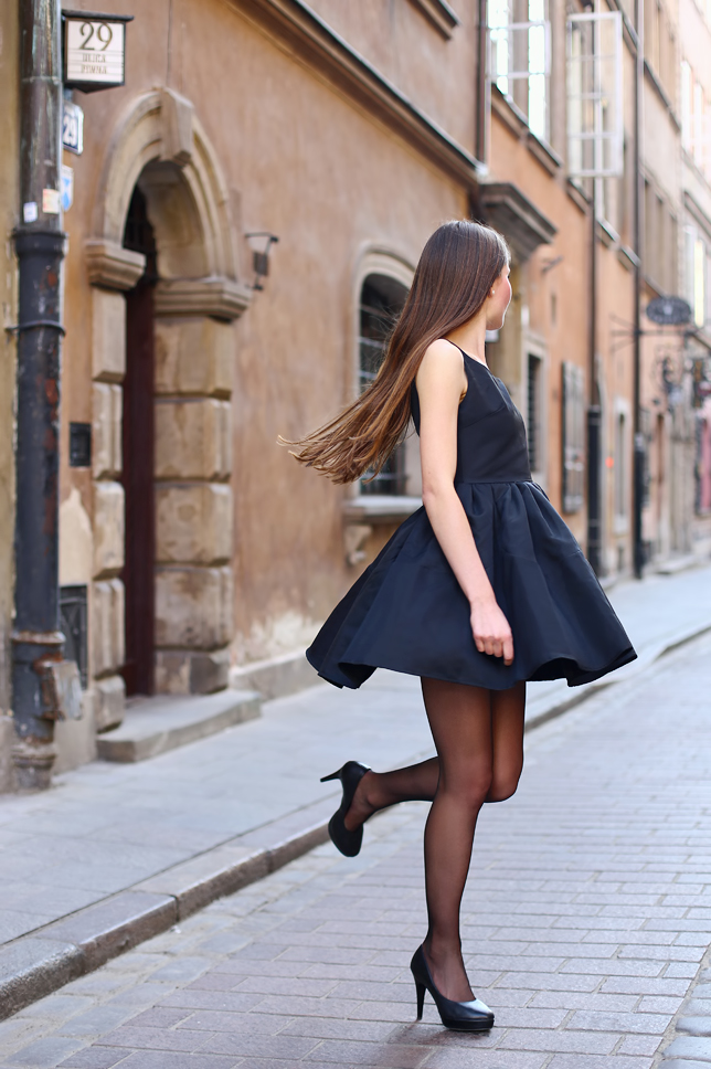black flared dress black tights heels outfit