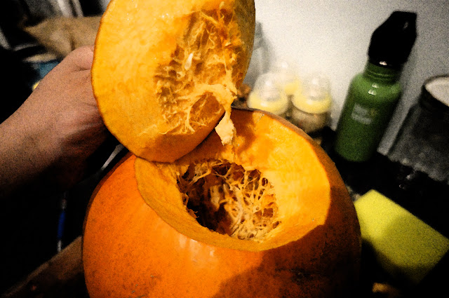 Picture of a Golden Nugget Pumpkin with the top cut out.