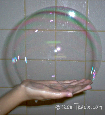 Holding A Big Bubble