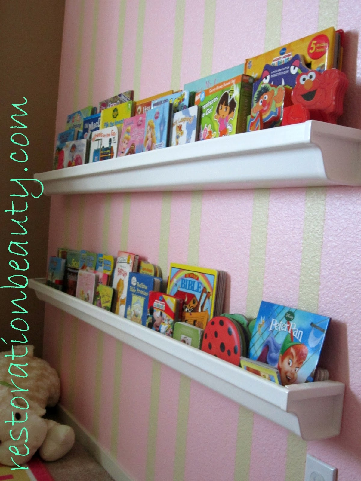 Restoration beauty rain gutter bookshelves for Plastic rain gutter bookshelf