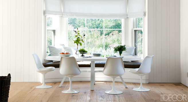 sillas y mesa Tulip decoracion moderna vintage en el comedor