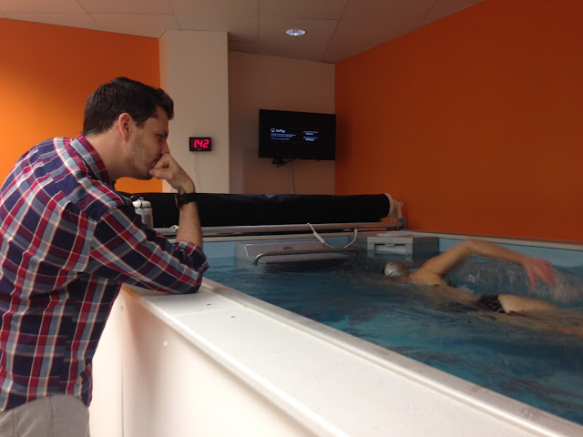 Coach Dominic Latella observes a client's swim stroke in the Performance Endless Pool at SwimBox in Fairfax, Virginia