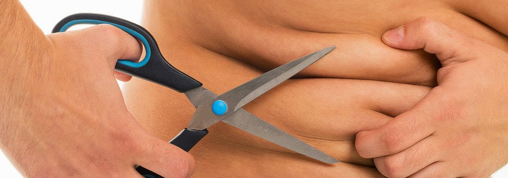 bariatric surgery concept: person with scissors about to cut the fat