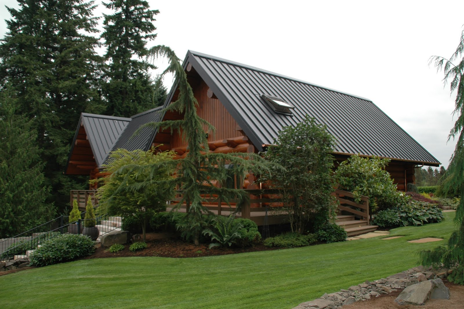 I love metal roofs sterling roof and copper gutters for Black roof house
