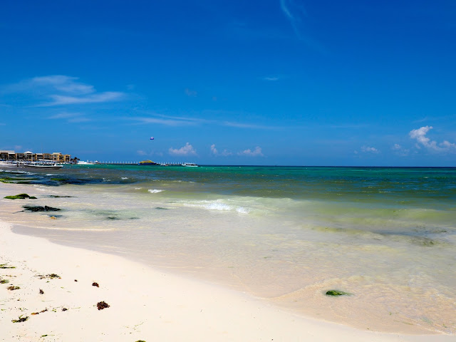 Sand and blue ocean at the beach in Playa del Carmen, Mexico