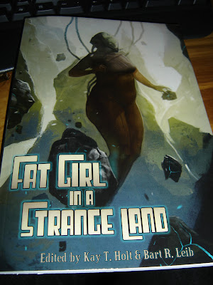 Cover of the Fat Girl In A Strange Land anthology, a fat woman in a space suit floating amongst rocks