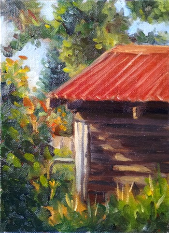 Oil painting of a grey weatherboard shed with a red roof, surrounded by trees and shrubs and illuminated by the afternoon sunlight.