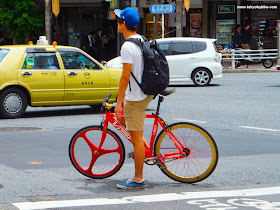 Fixed gear bicycle commuter in Tokyo, Japan