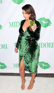 Kim Kardashian holding a drink