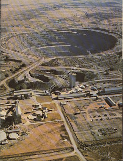 An aerial view of the opencast workings of the Finsch Mine, with the treatment plant in the foreground.