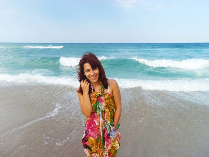 Me standing on the beach at the sea coast wearing a big colorful scarf as a cover up in Sozopol, Bulgaria