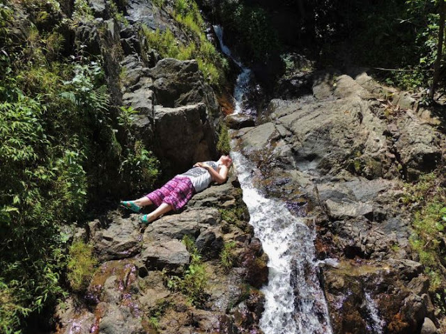 Chilling out at a waterfall in Thai harem pants
