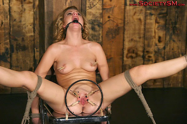 pussy stretched open with clamps