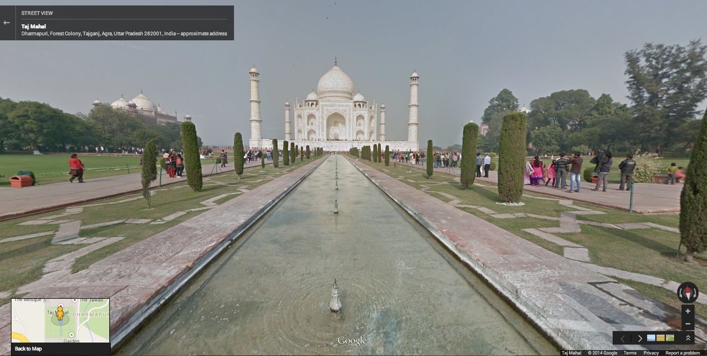 A view of the Taj Mahal across a gorgeous garden and fountain area.