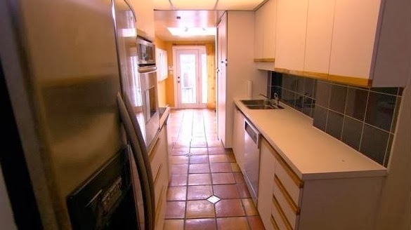 Dingy and cramped gallery style kitchen before makeover