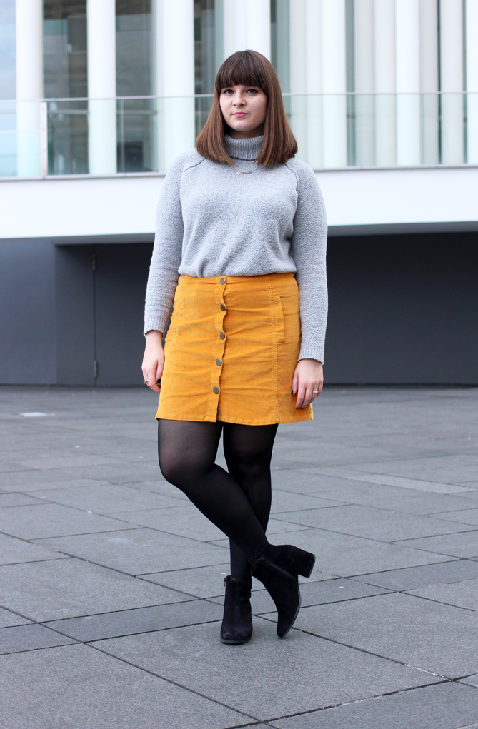 combine A-line skirt with turtleneck sweater