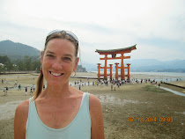 American visitor at O-torii Gate of Itsukushima Shrine at low tide, Miyajima Island, Japan