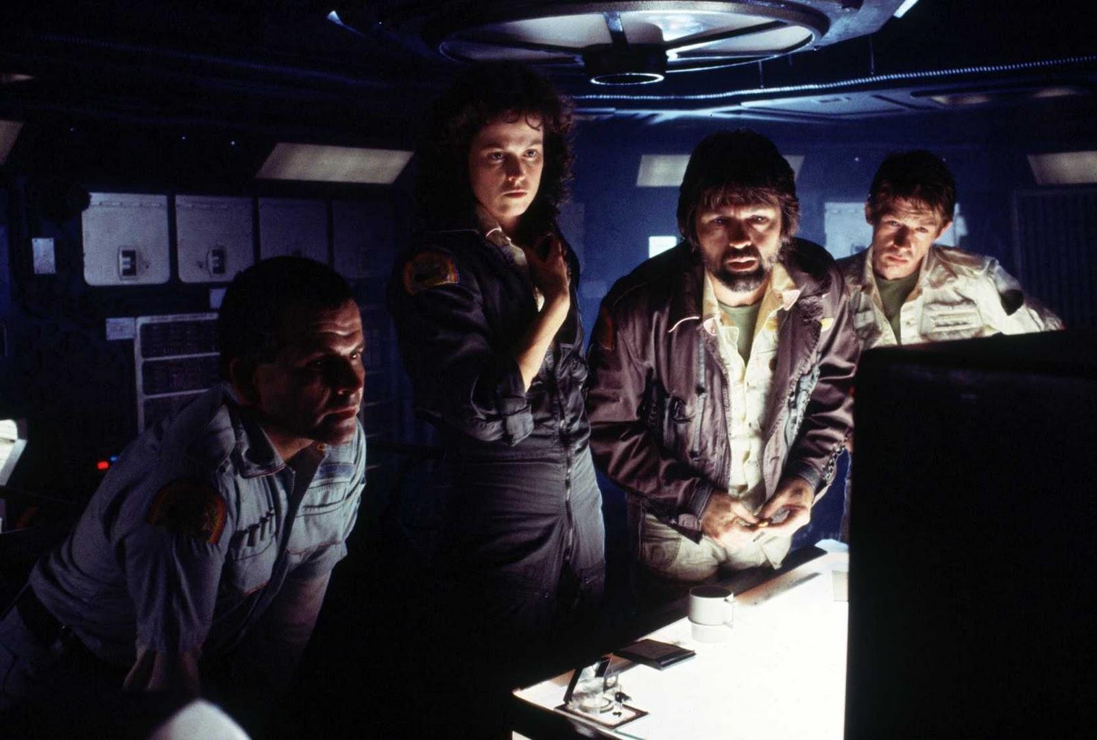 Ash (ian Holm), Ripley (sigourney Weaver), Captain Dallas (tom Skerritt)  And Kane (john Hurt) Make A Planetary Analysis In A Scene Cut From The Film
