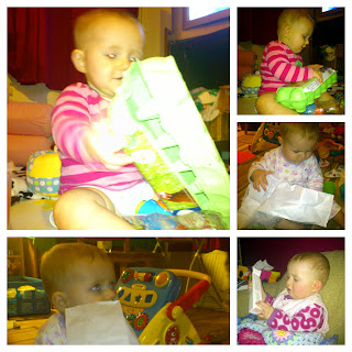 baby playing with egg box and paper bag