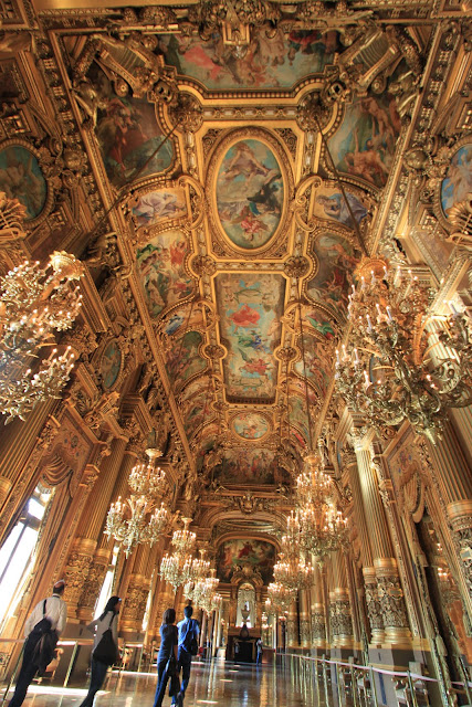 Rich with gold decoration at The Grand Foyer of Le Palais Garnier Opera House in Paris, France