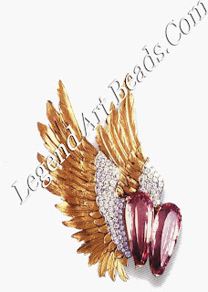 A pair of pink topaz, aquamarine, and diamond wing brooches designed for Lady (Slim) Keith, c. 1968, and an aquamarine and diamond-wing heart brooch.