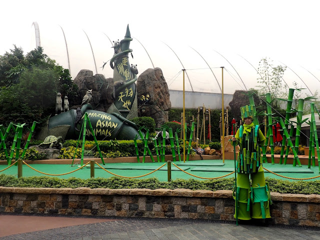 Asian Animals exhibit, with man in bamboo costume, in Ocean Park, Hong Kong