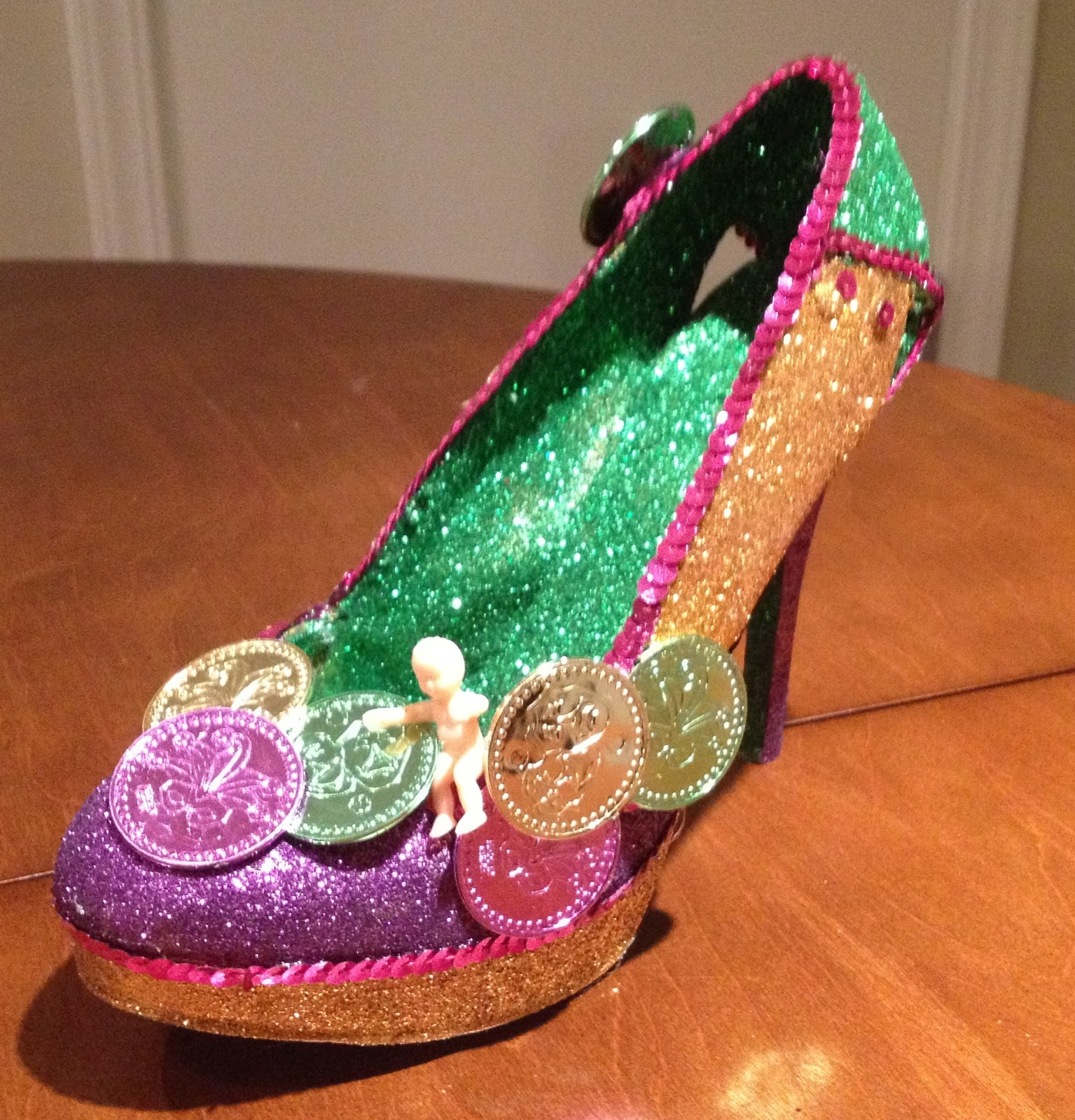 King Cake Baby Hanging Out In The Clusters Of Doubloons On The Front Of The Shoe Sole And Interior Were Glittered Green