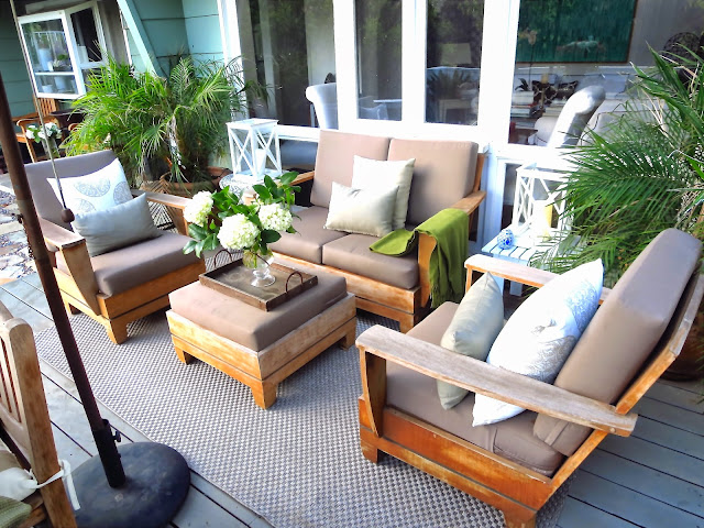Outdoor living room with neutral teak furniture