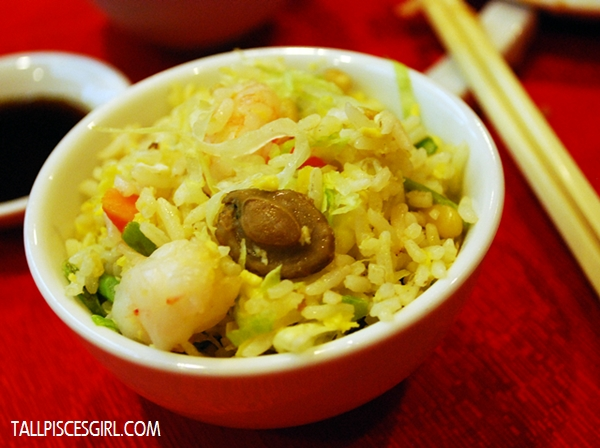 The cute mushroom in my bowl of Abalone Seafood Fried Rice with Pine Seed
