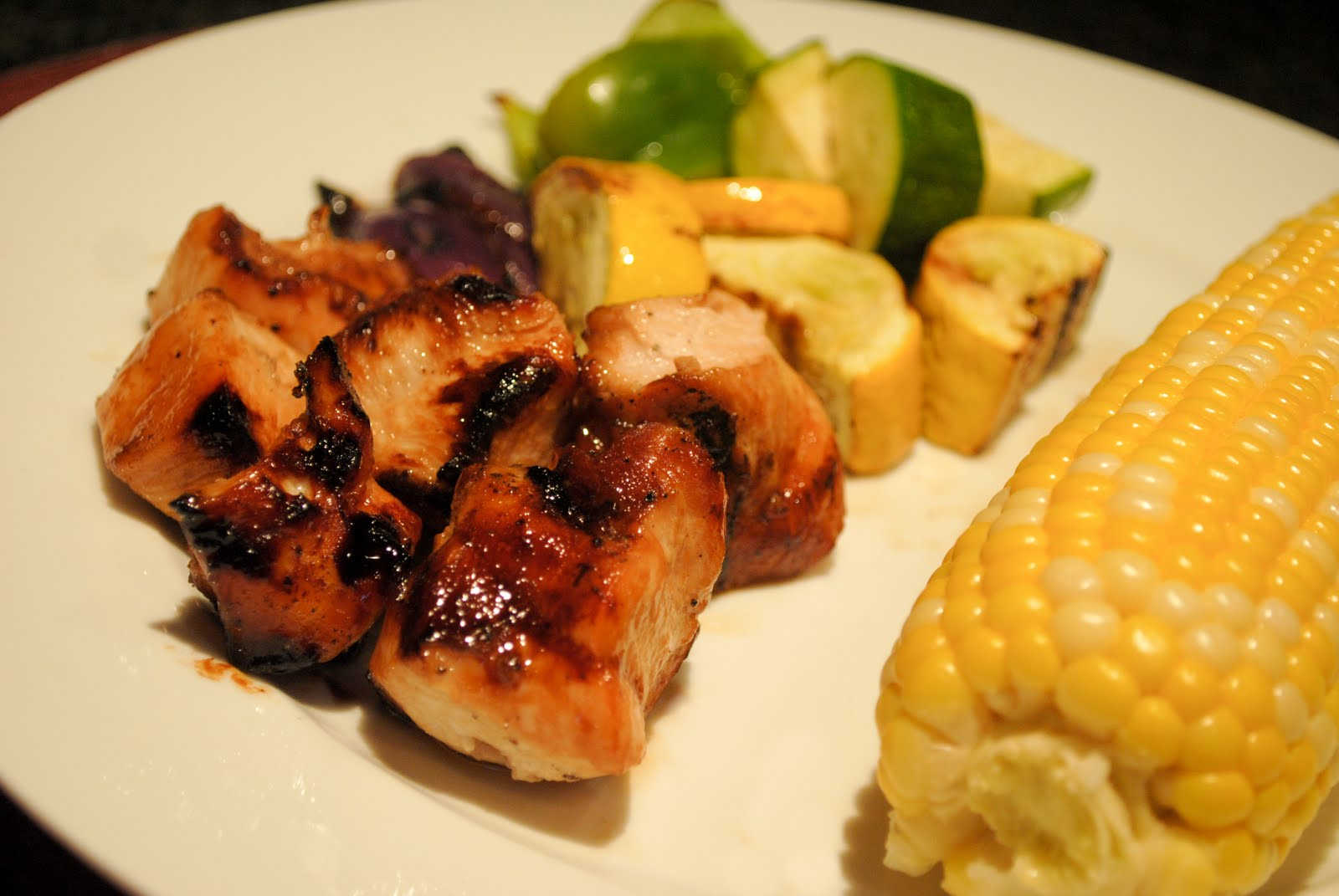 Asian Honey Chicken kebabs with grilled red onion, zucchini and squash ...