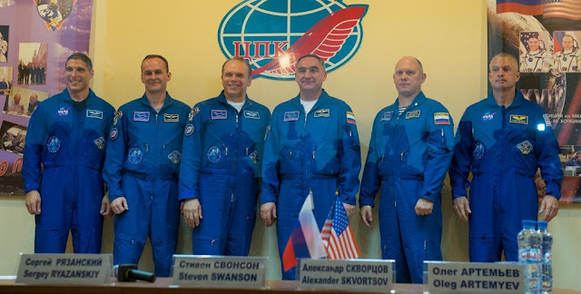 Expedition 37 NASA Flight Engineer Michael Hopkins, far left, Soyuz Commander Oleg Kotov, Russian Flight Engineer Sergey Ryazanskiy, backup crewmembers Steve Swanson of NASA, Alexander Skvortsov of Russia and Oleg Artemyev of Russia, far right, are seen posing for a photo following a press conference held at the Cosmonaut Hotel, on Tuesday, Sept. 24, 2013, in Baikonur, Kazakhstan. Photo Credit: (NASA/Carla Cioffi)