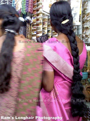 Beautiful chennai Aunt with long hair braid at street shopping.