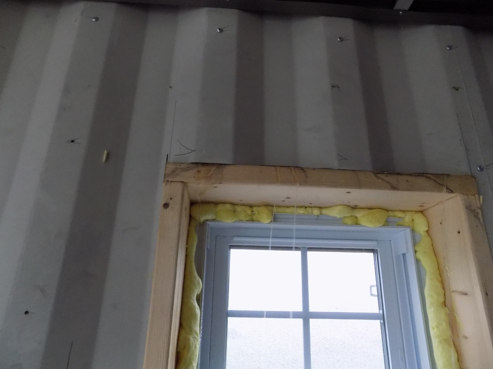 Intermodal house strapping on windows in insulation for High insulation windows