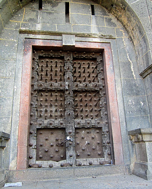 giant door of an ancient fort in saswad