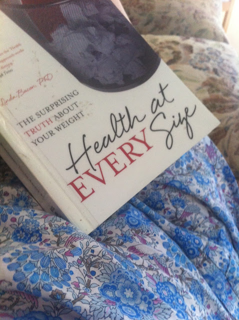 Photo of the book Health at Every Size in my lap.