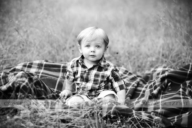 black and white outdoor photo of a toddler boy