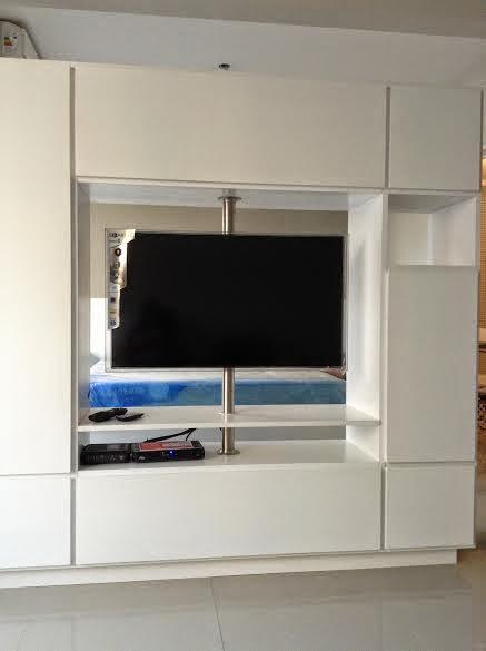 cao giratorio con soporte para tv