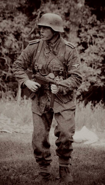 Waffen-SS Stormtrooper with MP 40 in combat.